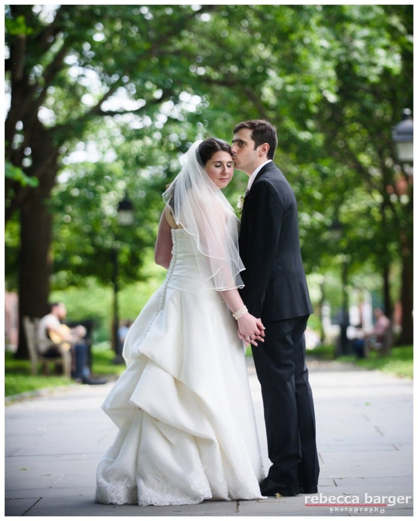 Jess and Eric share a little kiss in Washington Square, close to Morris House Hotel, just before their wedding reception.