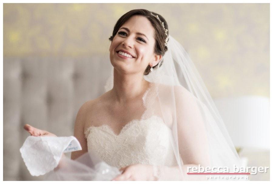 Rachel opens her wedding day gift from Stuart, an embroidered handkerchief.