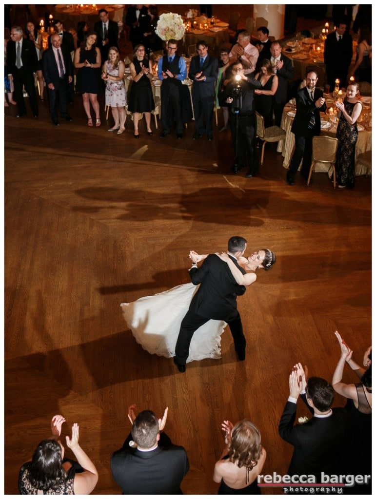The couple ends their first dance with a romantic dip, in the Grand Ballroom at The Hyatt at Bellevue, Phila., entertainment by EBE Barcelona.