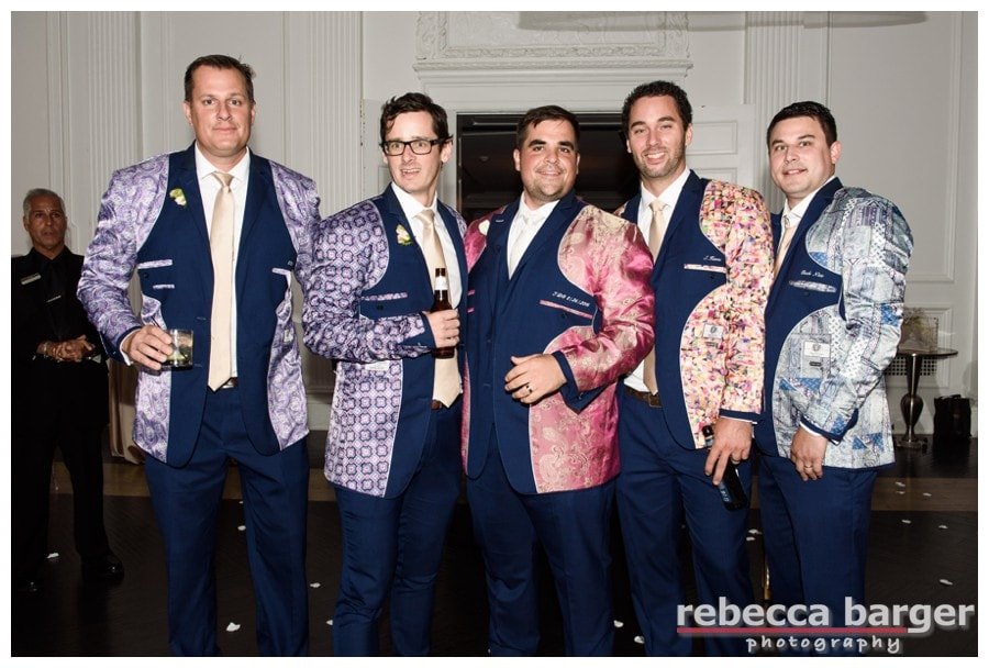 Lawrence and his groomsmen turn their jackets inside out!