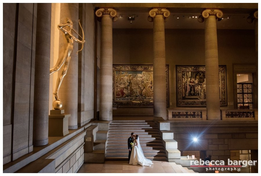 Ben + Holly share a wedding day kiss underneath the watchful eye of Diana who has reigned as the goddess of the Phila. Museum of Art's Grand Stair Hall since 1932, prior to then she was on top of  NY's Madison Square Garden as a weathervane.