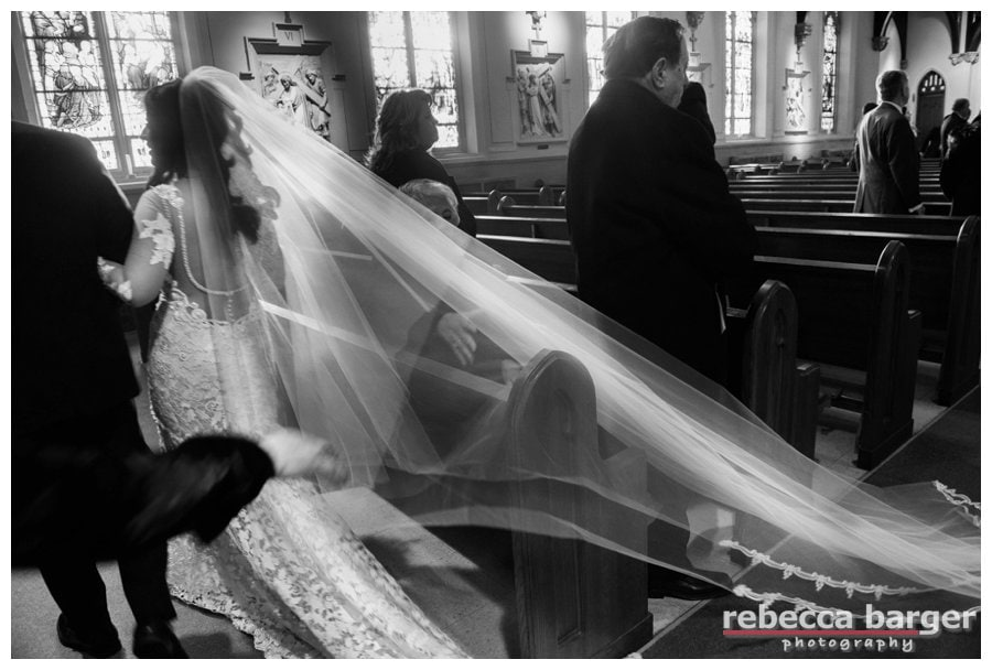 Adriana wore her mother's veil, chapel length.  Just think, that veil was worn by her mother in the same church.