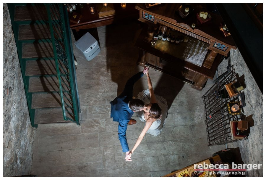 Tim and Jackie share a kiss in the wine cellar at Knowlton Mansion.