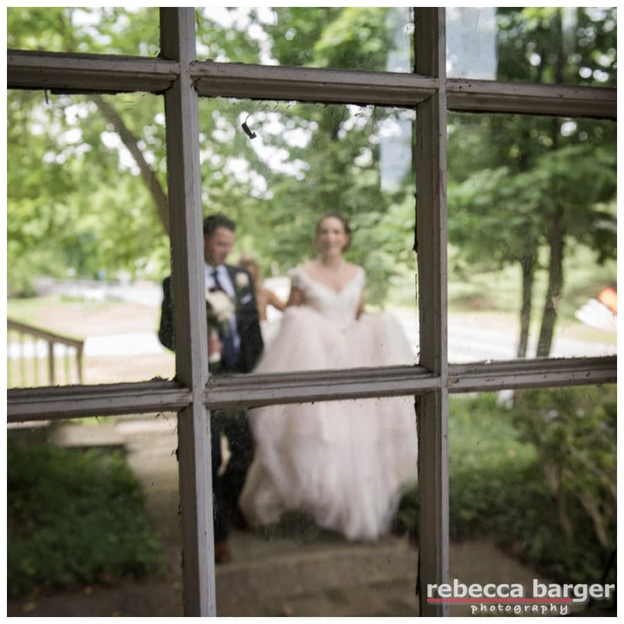 Love this image of Becca and Dave through the original rustic glass at Hotel du Village.