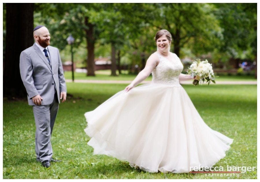 Katie shows Jordan that gown in motion, flowers by Sommerfield Designs.