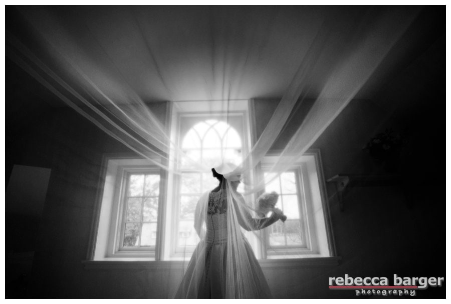 Love this photo of Kiera right after she finished dressing in her childhood home, wedding gown and veil by Pronovias from Van Cleve Bridal.