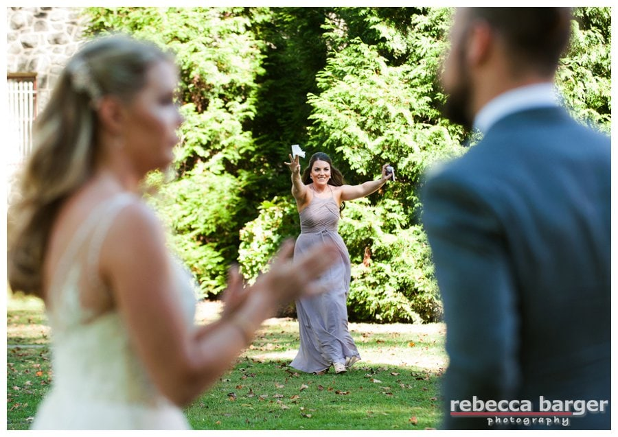 Audrey, sister of bride, rushes to the rescue with tissues for the crying bride.